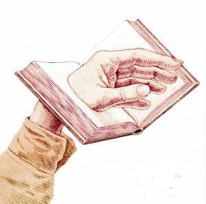 Main dans livre